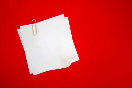 notes with clip on red background Stock Photo