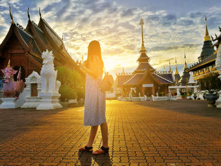 Young asian tourist woman explores Wat Ban Den Buddhist temple located in Chiangmai province, Thailand