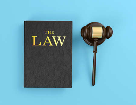 Wooden judges gavel and law book on blue background, 3D Rendering