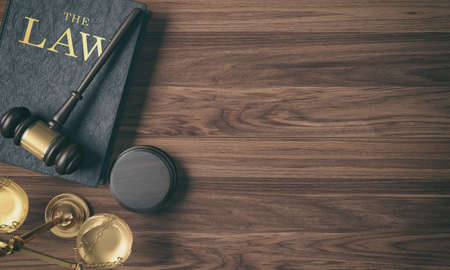 Low key filter wooden judge's gavel on law book and golden scale on wood background on top view, 3D Rendering