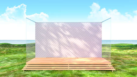 Empty stage backdrop platform in green grass field with sea view background, 3d rendering 写真素材