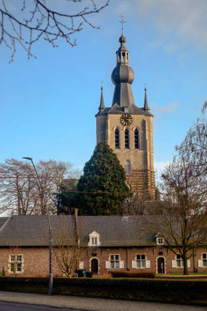 The tower of the Church of Our Lady dominates the small city of Aarschot in Flemish Brabant. The small, old houses in the foreground are part of the former beguinage.