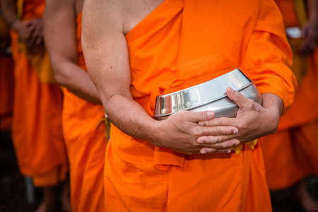 limosna: BUDDHIST MONKS : Thai Monks walking in the morning for Receive Food , Thailand.