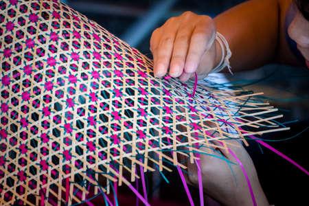 Close up Hands  weaving a woven mat   Thais artwork.
