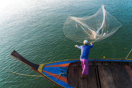 Muslim Fisherman Fishing Nets,Andaman Sea off the coast, Ranong Southern Thailand 版權商用圖片