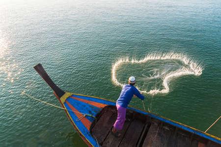 Muslim Fisherman Fishing Nets,Andaman Sea off the coast, Ranong Southern Thailand Stock Photo