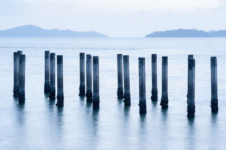 Stakes in the sea Stock Photo