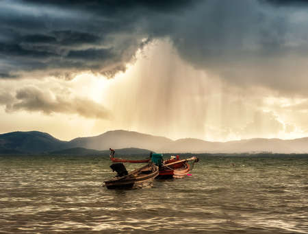 Long tail Boat at sea, background rain drops ,Thailand Stock Photo