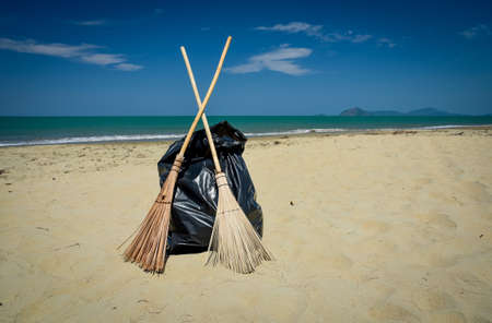 Cleaning day, broom and black garbage bag on the beach, Andaman Sea off the coast of, and part of, Phuket Province, southern Thailand