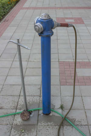 hydrant water is used for watering flowers photo