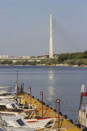 phoenicians: Boats at Marina, Ada Bridge in the background. Shot on Sava River in Belgrade, Serbia