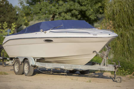 recreational boat: Boat on a Trailer in Boatyard, waiting for launching
