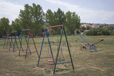 Located near the parking, this is a little playground. Equipped with a basic metal swings, and old style metal see-saws, most kids today would be bored.  photo