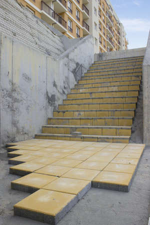 pave: Paving Stairs with Yellow Paving Stone at construction site