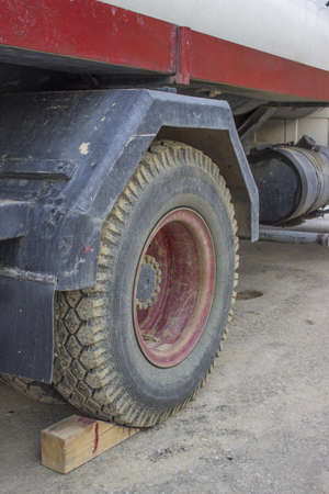Rear Wheels, Wheel Chock and fuel tank of the old truck photo
