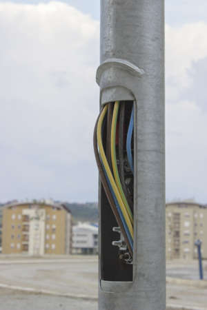 copper wires in street light pole, small plate missing photo