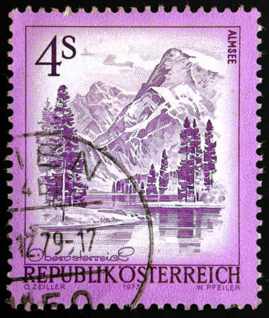 Austrian postage stamp, shows image of alpine lake is a lake in Upper Austria in Austria Almtal, south of the city of Grünau, circa 1973.  photo