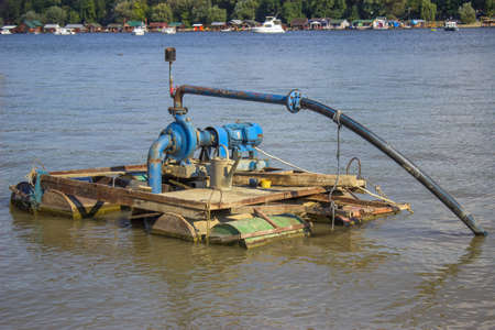 Electric water pump on river Sava, in Serbia. Stock Photo - 22986515