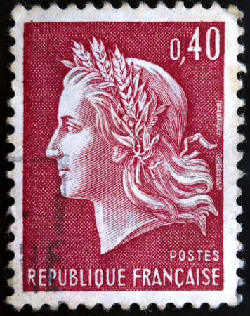 French postage stamp shows Marianne the allegory of the French Republic photo
