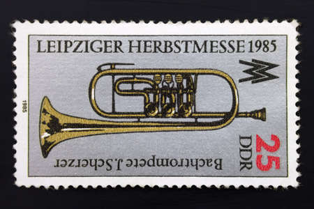 German postage stamp 25 Ddr. Bach trumpet J.Scherzer, Leipzig Autumn Fair 1985 Oblitere. The Leipzig Trade Fair was a major fair for trade across Central Europe for nearly a millennium.