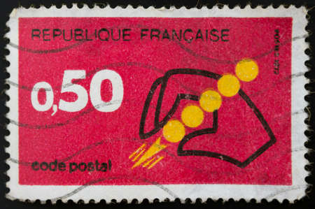 50c French postage stamp. Hand Holding Symbol of Postal Code Introduction of Postal Code photo