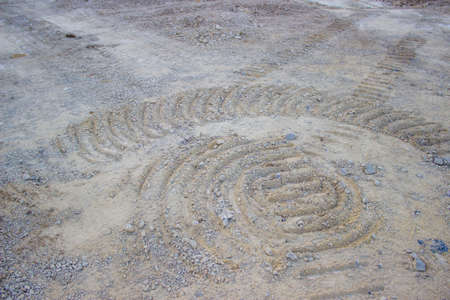 caterpillar track in sand at construction site photo