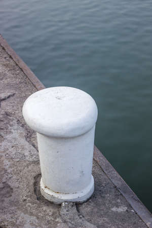 mooring bollards: Bollard is iron post found as a deck-fitting on a ship or boat, and used to secure ropes for towing and mooring. on the river Sava in Belgrade