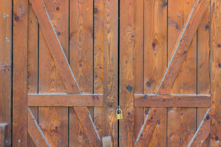 old wooden door with locked padlock, entrance to the warehouse photo