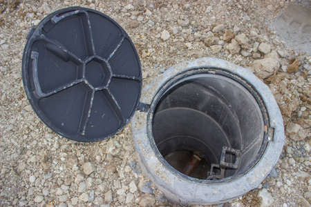 Sanitary sewer under construction, view looking down into an open manhole