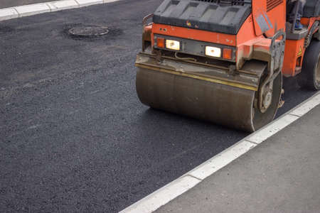 vibroroller: mini compactor roller during road construction at asphalting work