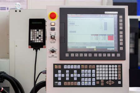 panel: Control panel of a cnc machine. Programmable machine. Selective focus and shallow dof. Stock Photo