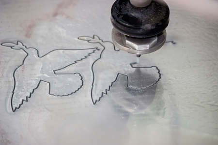 metal cutting: High pressure waterjet aluminium cutting. Selective focus and shallow dof.