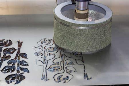 Cutting metal with plasma. CNC plasma cutting machine. Selective focus and shallow dof.