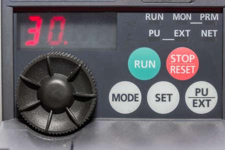 machine operator: Close of industrial machine operator panel. Selective focus. Stock Photo