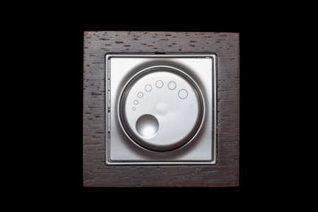 dimmer: Electric dimmer light switch on black background