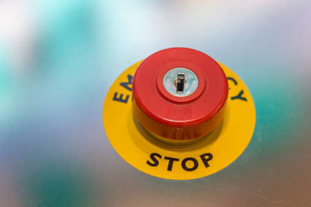 Red emergency stop button on machine for safety. Stop button switch. Selective focus and shallow dof.