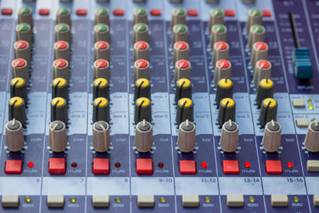 adjuster: Buttons on sound mixer control panel. Selective focus and shallow dof. Stock Photo