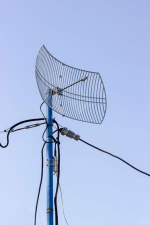 outage power: Outdoor grid wireless parabolic directional antenna on pole