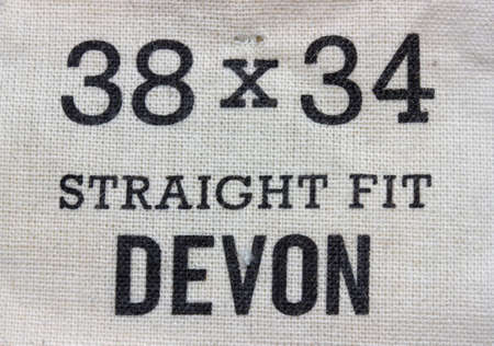 38: Size label for jeans pants. Label for clothing, size 38 x 34 straight fit