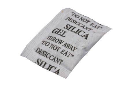 porous: Silica gel in a porous packet isolated on white with clipping path