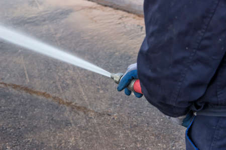 hosepipe: Using water hose to clean road by high pressure water