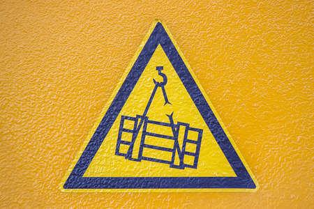 crush on: Safety sticker on telescopic crane. Overhead crane crush hazard sign.