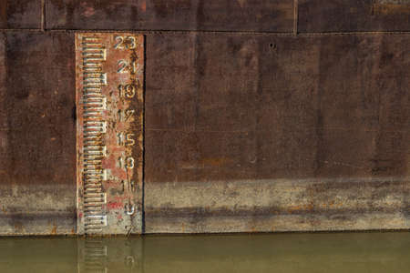 depth gauge: Plimsol Line or load line, which is a visible line designed to protect sailors from ships being loaded with too much cargo. The mark is printed onto the sides of cargo ships.