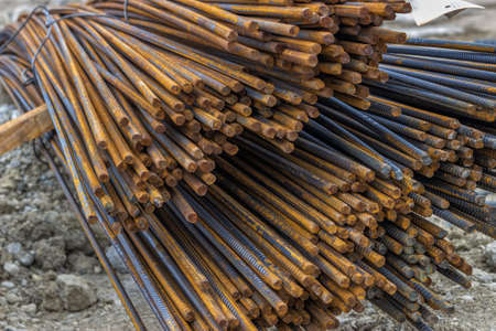 strong base: Steel reinforcing bars for reinforcing concrete. Manufactured with deformations on the surface that aid in creating a bond between the bar and the concrete. Selective focus. Stock Photo