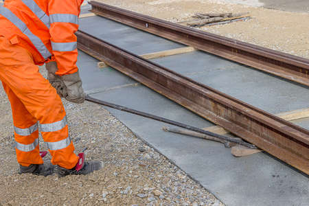 Preparation for rail welding process. Align piece of railroad track before welding.