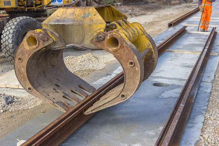 rail track: Alignment of tram rail track  before welding. Installation of tram tracks. Assembling a tram rail track. Stock Photo