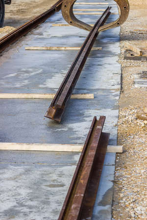 rail track: Alignment of tram rail track ends before welding. Installation of tram tracks. Assembling a tram rail track.