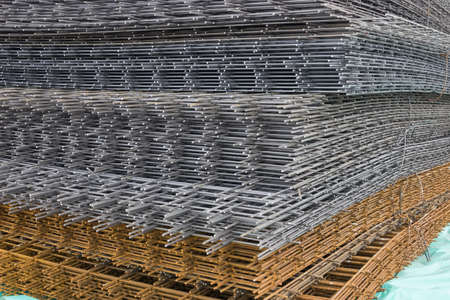 Reinforcement steel mesh background at the construction site. Mesh and bar. Stock Photo