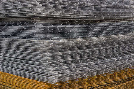 construction mesh: Reinforcement steel mesh background at the construction site. Mesh and bar. Stock Photo