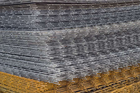 welded: Welded iron mesh panels for reinforced concrete background at the construction site. Bar mat reinforcement mesh.